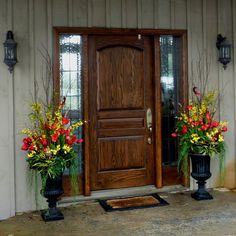 Matching Spring Urns With Colors Red and Yellow Reminding Us Of Sunshine!
