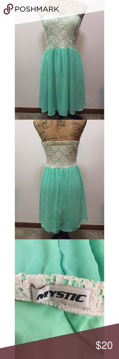 Mystic Mint Tube Dress Measurements - Bust 14 (28) Length 28in Unzips at the side. In beautiful condition. Chiffon like material at the bottom and has a slip underneath. Mystic Dresses Strapless