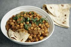 """A can of chickpeas, a few of what my mum calls the """"usual"""" spices and dinner can be on the table in no time with this Chana Masala. While raw chickpeas are great when soaked overnight and then cooked, a can makes a useful shortcut on busy days and this is my go to family recipe armed with a roti or pitta bread or two. Ingredients (feeds 2) •  1 small onion •  1 garlic clove •  Half inch ginger •  1.5 tbsp of sunflower oil •  1.5 tsp ground coriander"""