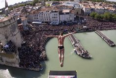 In this handout image provided by Red Bull, Artem Silchenko of Russia dives from the 27.5 metre platform on the Saint Nicolas Tower during the first stop of the Red Bull Cliff Diving World Series on May 25, 2013 at La Rochelle, France. (May 24, 2013 - Source: Handout/Getty Images Europe)(Photo by Romina Amato/Red Bull via Getty Images)