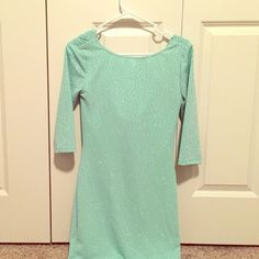 ASOS Light aqua sparkly swoop dress This dress is very sparkly and is light Aqua. The front is conservative, yet the back swoops down. Form fitting and in perfect condition. Only worn twice. ASOS Dresses Long Sleeve
