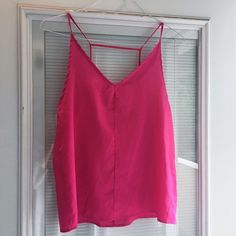 Hot Pink Top Hot pink chiffon tank top with back detail. Lovely flowy top perfect for Spring summer paired with some jeans. I couldn't find a size but I'm guessing S. Tops Tank Tops