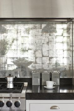 Glamorous custom-made silver leaf splashback in a bespoke Mowlem & Co kitchen.