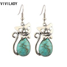 Ancient Turquoise Stone Guardian Angel Cat Earrings These ancient turquoise stone guardian angel cats are keeping a look out for your tender heart. They know th