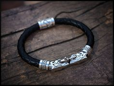 Check out this item in my Etsy shop https://www.etsy.com/listing/532327177/leather-bracelet-wolfs-for-men-by