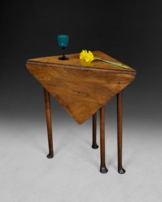 """A very pretty George II solid Walnut Corner Table, the well figured top opening to a square from a triangular top supported on a single gate leg above a Walnut frieze and the whole raised on four turned legs terminating in pad feet. Circa 1730 Closed: H:24.5"""" 62cms  W:24.5"""" 62cms, D:""""12.5  32cms Open: H:24.5"""" 62cms  W:18.25""""46.5cms, D:18 25""""46.5cms."""