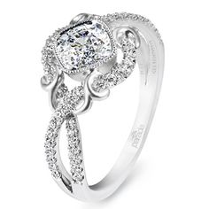 IF I WERE to get engaged, I would want a ring something like this, except with something OTHER than a diamond in the center. I'm odd, but I LOVE the idea of an engagement ring with a ruby or an emerald for the center :)