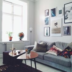 grey sofa, art wall, ikea/teak coffee table | Emma Solveigsdotter, via instagram