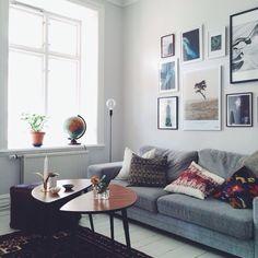 grey sofa, art wall, ikea/teak coffee table | Emma Solveigsdotter, via instagram