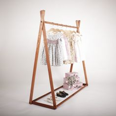A gorgeous natural Clothes Rack, perfect for putting your child's favourite things on display