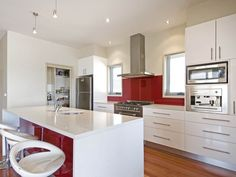 This kitchen, except with Aqua splashbacks instead of red... ooooh yeahhhh....