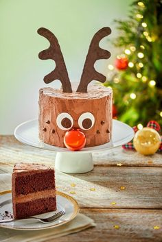 Chocolate Rudolph cake with a bauble for his red nose. Recipe and printable template