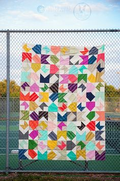 Lovely quilt done in all Cotton & Steel basics.  See site for other color variations of this quilt. HST and flying geese.