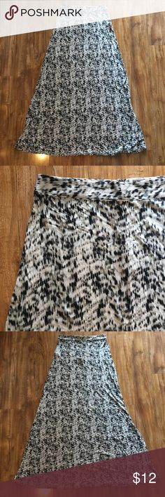 Forever 21 Maxi Skirt Black and Tan print. In great condition. Never worn. Size small. Fits sizes 2-4. Forever 21 Skirts Maxi