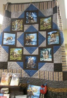 This quilt is so striking and is really a must have. We have used the Charisma Quilt Pattern in the Circle of Nine Book and it really highlights the wildlife in the quilt. Fabric Panel Quilts, Fabric Panels, Quilting Projects, Quilting Designs, Wildlife Quilts, Attic Window Quilts, Photo Quilts, Quilt Border, Animal Quilts
