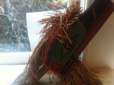 1990s Raven rattle carved by Sam Shaughnessy of Alert Bay (Vancouver Island, British Columbia, Canada). Purchased in Vancouver 1999. Alert Bay, is the bay of a small island of 556 people (Cormorant Is.) Northeast of Vancouver Island. Sam is a member of the Kwakwa̱ka̱'wakw (once called the Kwakiutl), which is one of the Kwakwala-speaking nations. The Raven is very important in Kwakwa̱ka̱'wakw mythology and is well known as a trickster.