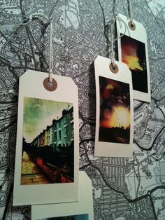 A world map with these photo gift tags to decorate-- how fun!