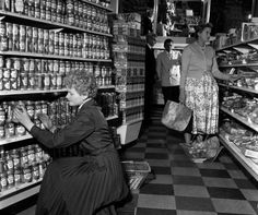 A general view of the Richmond Supermarket, showing a woman stacking shelves as a customer browses the… Uk Photos, Stock Photos, Stacking Shelves, Vintage Country, General Store, Vintage Recipes, Grocery Store, Childhood Memories, 1950s