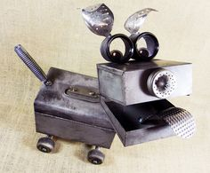 Hey, I found this really awesome Etsy listing at http://www.etsy.com/listing/151836935/barker-robot-dog-assemblage-sculpture