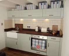 Quaint wood seaside/country kitchen with belfast sink in our beautifully renovated cottage for sale in Polperro, a Cornish fishing village. http://www.rightmove.co.uk/property-for-sale/property-31535934.html.