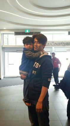 Seeing Taec with children is the most precious sight in my eyes the way they gravitate towards him and the way he acts around them. so adorable! That ladies and gentlemen is a REAL MAN ! Ok Taecyeon, Best Kpop, Asian Celebrities, Korean Men, Lady And Gentlemen, Real Man, Sexy Men, Gentleman, Acting