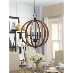 @Overstock - Vineyard Orb 4-light Chandelier - Rustic enough to please a Norse god while remaining perfect for the modernist with it's clean, open design, this chandelier's distressed wooden sphere is complemented by metal hardware. The candelabra bulbs add to its versatile appeal.  http://www.overstock.com/Home-Garden/Vineyard-Orb-4-light-Chandelier/9415473/product.html?CID=214117 $202.99