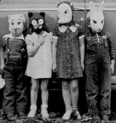 creepy small children wearing animal masks