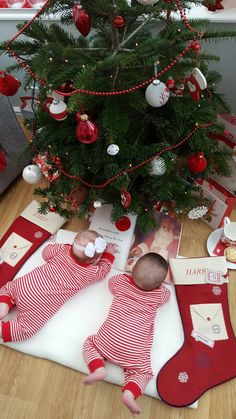 Our baby twins first Christmas. 4month old boy girl twins.