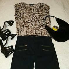 Leopard Top Sheer, sleeveless blouse with small pocket. Bronze studs around neckline and pocket excellent condition. Tops