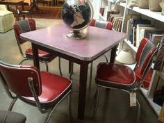 Vintage table with four red and chrome chairs $755 by iheartleftovers, via Flickr