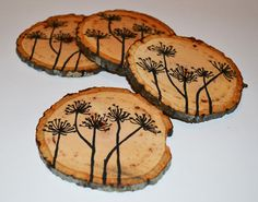 hand painted natural wood coasters in a quirky and earthy natural design. $20.00, via Etsy.