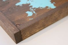 """This reclaimed world map is the perfect rustic wall decor. Its made from reclaimed wood that has been sanded, stained and then hand-painted in the colour Turquoise. It measures approximately 12 1/2"""" wide x 12"""" tall and about 1 ½"""" thick. If you are looking for a unique piece of art for you home, this is the piece for you. Each map has its own unique character, no two maps are the same! This map is the perfect size for a gallery wall and comes ready to hang. Return to my main page shop: t..."""