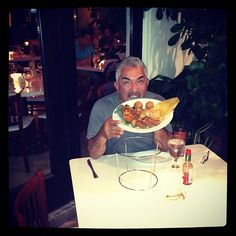 Cesar enjoys the local food [Bongos Combó] in Miami, FL.