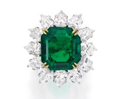Very Fine Platinum, 18 Karat Gold, Emerald and Diamond Ring, Harry Winston, maker's marks for Jacques Timey. Centered by a 9.84 carat square emerald-cut emerald framed by 7.80 carats of pear-shaped diamonds.