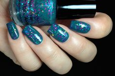 Don't Teal Anyone. Teal base with different sizes of gold, turquoise and fuchsia purple hex glitters. I can also see a small amount of bar fuschia glitters. The color combo looks fantastic and I love how sophisticated it is. I also used 2 coats for full opacity.