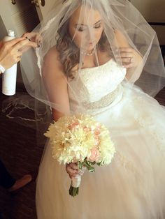 Hairspray a veil to help keep it in place and off a brides face