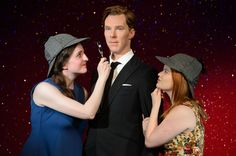 Now that's cute. Two lucky fans who won a competition to attend a private viewing of the Benedict Cumberbatch wax figure don Sherlock Holmes' signature deerstalker hat