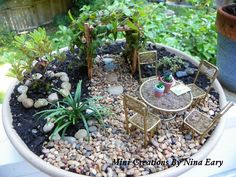 Thank you Joanne for the adorable little heart-shaped rocks that I used for stepping stones in my new container Fairy Garden!!  ~created by Nina Eary~