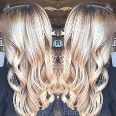 Beautiful bright blonde balayage and curls