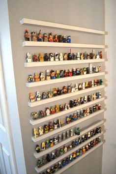 Keep minifigure madness at bay with a storage wall that's also a display. | 40 Smart Tricks To Keep Your Kids Organized