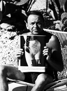"""I've heard of straight jackets, iron lungs and chain mail, but this is ridiculous!""  Frank Sinatra holds up a girdle ad for biographer and photographer Robin Douglas-Home by the pool, 1961"