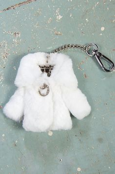 Buy one for yourself and another for a gift for your best friend! Our Rex Rabbit Coat keychain is a tiny fur coat with collar, sleeves, decorative front snap, and a suede lining.
