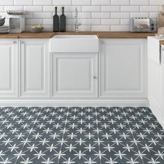 Let your floor take center stage with these beautifully patterned tiles, or use them as a fun backsplash that draws the eye around the room with our Devon Charcoal Feature Tiles. These square tiles act as artwork and create a seamless pattern on a large wall or floor feature, or as feature tiles in a plain tile backdrop. Frost resistant, durable, and beautiful; these tiles are great additions inside and outside of your home. Types Of Floor Tiles, Grey Floor Tiles, Grey Flooring, Wall And Floor Tiles, Kitchen Flooring, Wall Tiles, Kitchen Tiles, Types Of Flooring, Floor Patterns