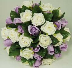 Incredible ivory and lavender roses.  http://bridalbasics.ca/gallery/Bouquets/bouquet8