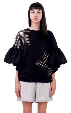 Ioana Ciolacu Daisy Black Sweatshirt is a loose cropped fleece sweatshirt with a placement screen printed front and back graphic and ruffle sleeves. Ruffle Sleeve, Daisy, Bell Sleeve Top, Short Sleeves, Style Inspiration, Shirt Dress, Sweatshirts, Outfit, Model