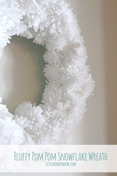 DIY Fluffy Snowflake Pom Pom Wreath, make a soft fluffy and easy snowflake wreath from pom poms! via littleredwindow.com  #winter #snow #christmas #holidays