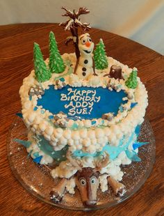 Addy Sue's Frozen cake! 10 inch round 2 layer cake, all edible!! Buttercream and candy clay Olaf, Sven and decorations! We tried a new technique with the frozen pond and ice shards! It is poured sugar, clear, completely edible and really cool! No fondant!  https://www.facebook.com/angelas.cakes2011