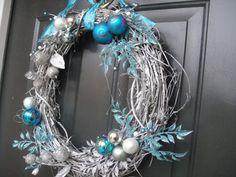 great idea painting the grapevine wreath silver - all kinds of options with that!