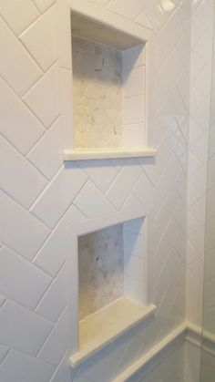 Herringbone white subway tile with Carrara marble hexagonal tile in his-and-her shower niches / cubbies by jeri