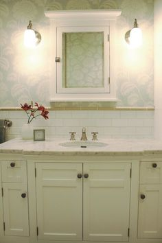 SVZ Interior Design: Sweet bathroom with blue floral wallpaper paired with subway tiles backsplash. White ...